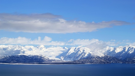 Scenic view of snow covered glaciers across the Kachemak Bay from Homer Alaska