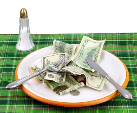 expensive: High price of food concept: Eating money Stock Photo