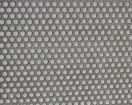 metal grate: Circular patterns in a metal grate Stock Photo