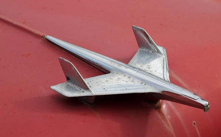 chrome: Closeup of a retro airplane hood ornament  Stock Photo