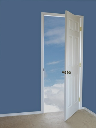 White door opening to a bright blue sky Stock Photo - 9779343