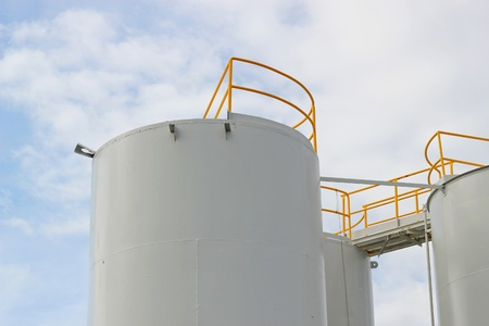 Large fuel storage tanks with a blue sky Stock Photo - 9951632