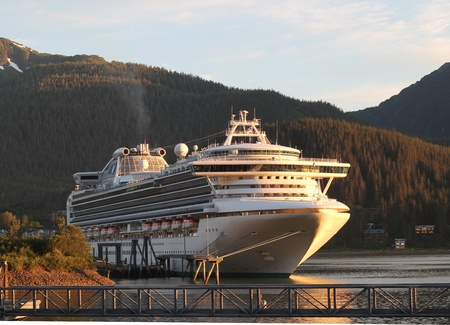 depart: Cruise ship starting to depart from port in Juneau Alaska Stock Photo