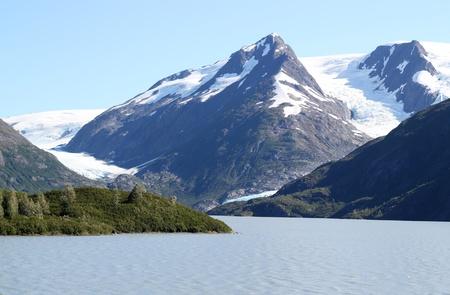 byron: Byron glacier in Alaska with portage lake below it on a sunny summer day