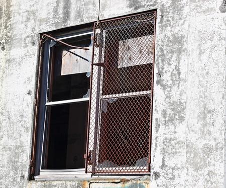 unoccupied: Broken window of an abandoned industrial building Stock Photo