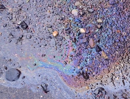 Oily sheen from spilled oil on ground wet from rain Stock Photo - 10508450