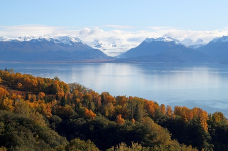 View of glaciers and mountains with the fresh snow across the Kachemak bay, Alaska with bright fall colors.