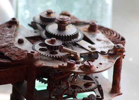 Close up of rusty gears of an obsolete mechanism