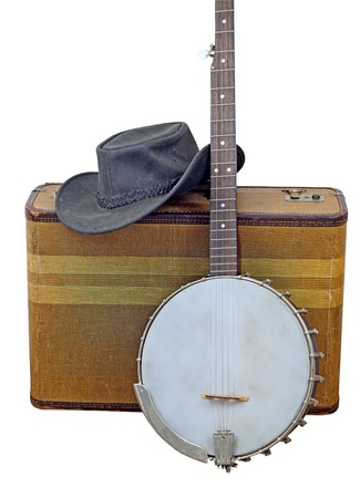 bluegrass: Old banjo, hat and suitcase isolated on white.