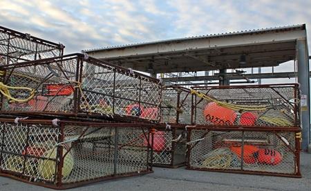 crab pots: Large crab pots stacked at the commercial fishing dock at Homer, Alaska during the off season.