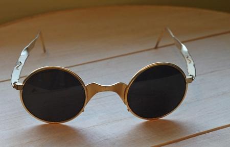 Close up of unusual vintage sunglasses sitting on wood. Stock fotó
