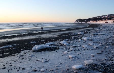 homer: Bishops beach in Homer Alaska on a cold winter evening at dusk with ice and snow.