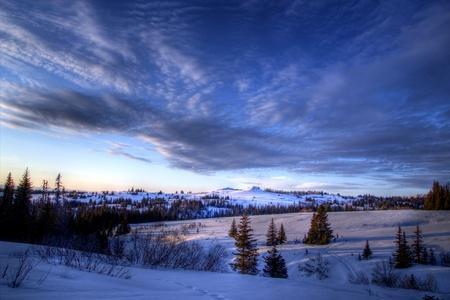 Streaming clouds in the evening sky in rural Alaska in winter. Archivio Fotografico