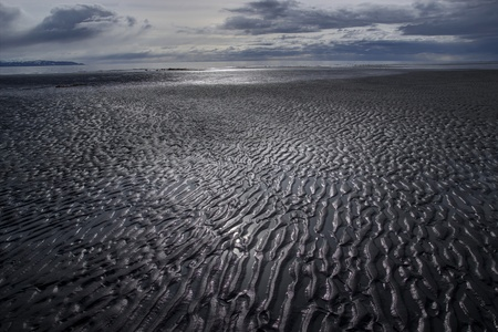 Mud flats in the bay at low tide with interesting patterns.