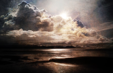 Dramatic cloudscape at the sea created with texture layers for an artistic look