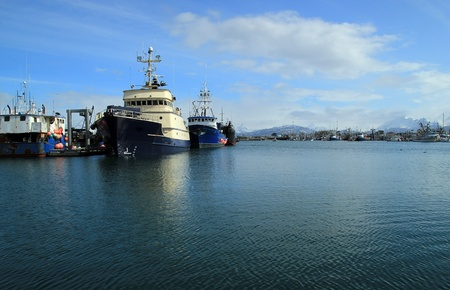 Large ships at the docks in Homer Alaska on a sunny day. photo