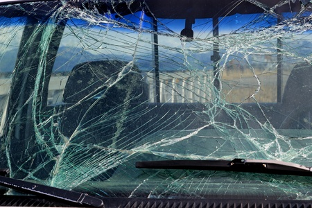 damaged: Broken car windshield glass in a car after an accident.