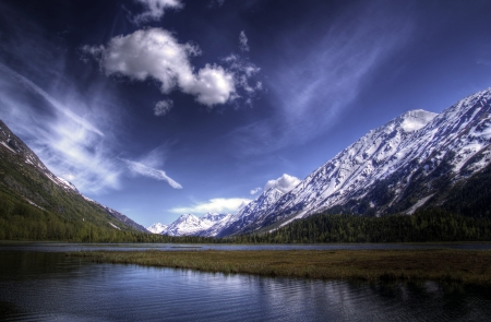 Tern Lake on the Kenai Peninsula in Alaska in summer with bright blue skies and nice clouds. Stock Photo