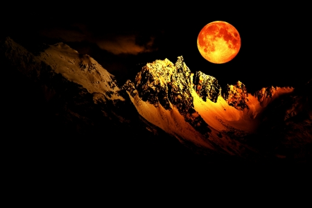 dark: Fantasy scene with a full moon over snow covered mountain peaks. Stock Photo