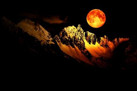 Fantasy scene with a full moon over snow covered mountain peaks. Archivio Fotografico