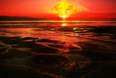 Fantasy post-apocalyptical scene with a nuclear explosion, red sky, and dead birds and bones on a desolate beach.