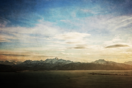 homer: View of the Kachemak Bay with the Homer Spit in Alaska with textures for a vintage look.