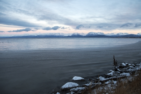 homer: Kachemak Bay near Homer Alaska in winter with ice chunks in the foreground.