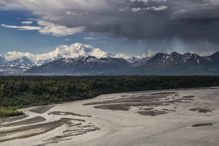 mckinley: Mt. Denali (Mr. McKinley) in summer with a riverbed in the foreground and storm clouds moving in.