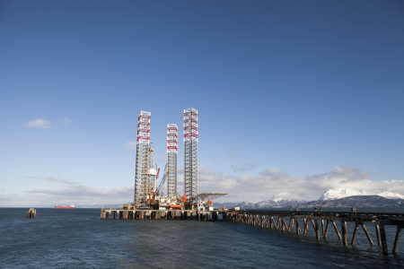 Jack-up rig parked at the harbor in Homer Alaska in winter on a sunny day. photo