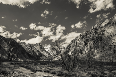 sierras: Stark canyon in the Eastern Sierras in California with clouds in black and white. Stock Photo
