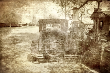 rural town: Old vehicle at a filling station in a rural town with a train in the background processed with textures for a vintage look  Stock Photo
