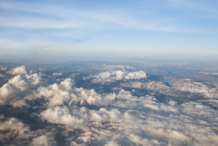 cascade range: View of mountains in the Cascade range of Oregon from the air with clouds and blue sky. Stock Photo