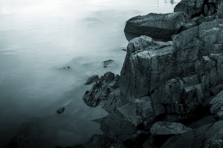 Monochrome image of rocks and water