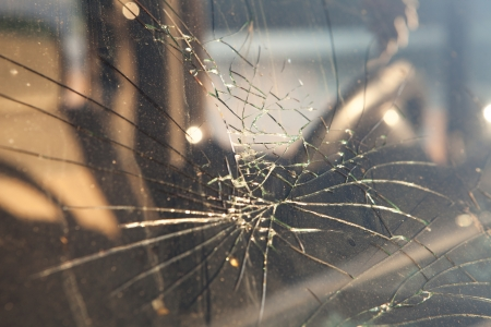 Cracked windshield after a car accident.