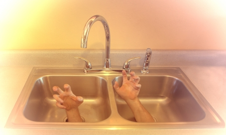 sink drain: Surreal shot with hands coming out the drain of a kitchen sink.
