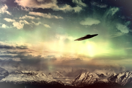 UFO in surreal sky with glowing light and clouds over snow covered mountains.