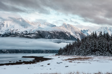 mud and snow: Sunset at Mud Bay near Haines Alaska in winter with fresh snow.