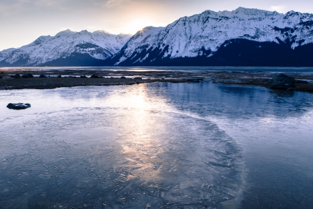 Ice patterns on an Alaskan beach near the Chilkat River at sunset. photo
