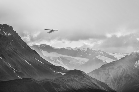 Small plane flying through the mountains of British Columbia.
