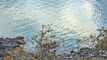 southeast alaska: Coastline off the Chilkat Inlet in Southeast Alaska in fall with rippled water.