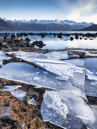 portage: Sheets of ice washed up near Portage Cove in Haines Alaska on a sunny winter day. Stock Photo