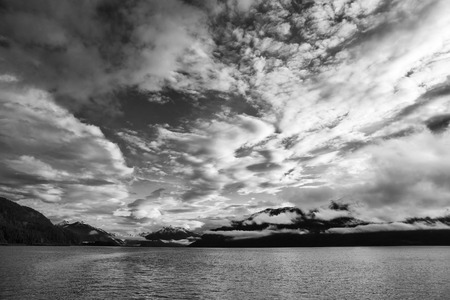 Dramatic clouds at sunset in Southeast Alaska in black and white.