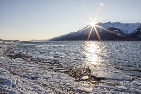 inlet: Ice chunks on the Chilkat Inlet near Haines Alaska at sunset on a cold winter day.