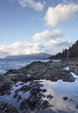 southeast alaska: Clouds reflected in water left by the outgoing sea near the Chilkat Inlet in Southeast Alaska.