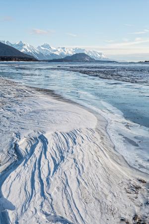wind blown: Patterns in wind blown snow beside a frozen Alaskan river.