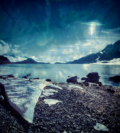 photomanipulation: UFO over an Alaskan beach with a large ice shard processed with texture overlays for a surrealistic look.