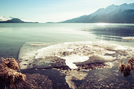 southeast alaska: Large chunk of melting ice on a beach in Southeast Alaska with vintage coloration. Stock Photo