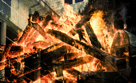 engulfed: Double exposure of an old building and a burning structure. Stock Photo