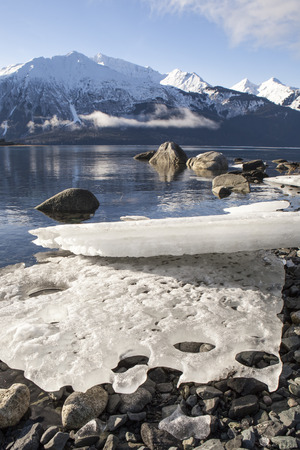 beached: Large beached ice bergs melting in sun in Southeast Alaska.