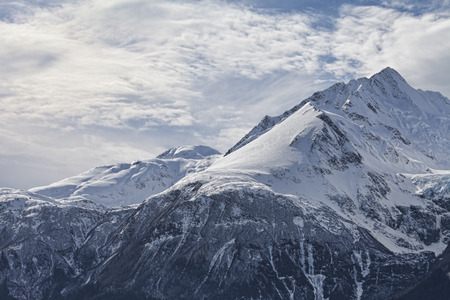 southeast alaska: Mountain peaks in the Chilkat range in Southeast Alaska with snow and clouds.